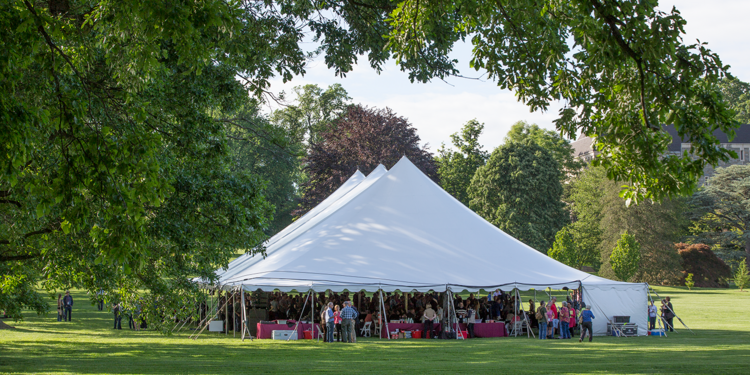 Alumni gather under the big tent on Parrish Beach