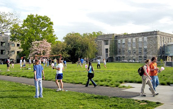 Students walking in front of Martin Hall on a warm spring day