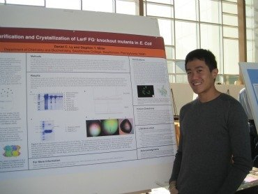 Daniel Ly '12 presents his research at the 2011 Sigma Xi poster session.