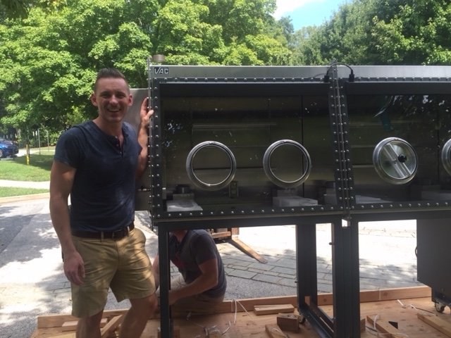Chris standing in front of the newly delivered double glovebox.
