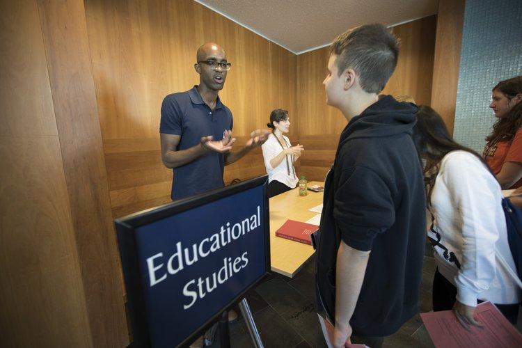 professor advising student at advising fair