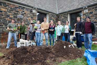 student group preparing to plant an herb garden near Sharples Dining Hall