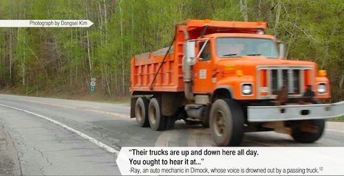 Truck driving on a rural road.