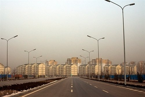 The empty city of Ordos in China, showing brand new buildings and road where no one lives