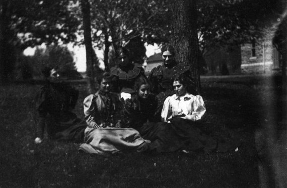Photograph of six female Swarthmore students sitting under a tree