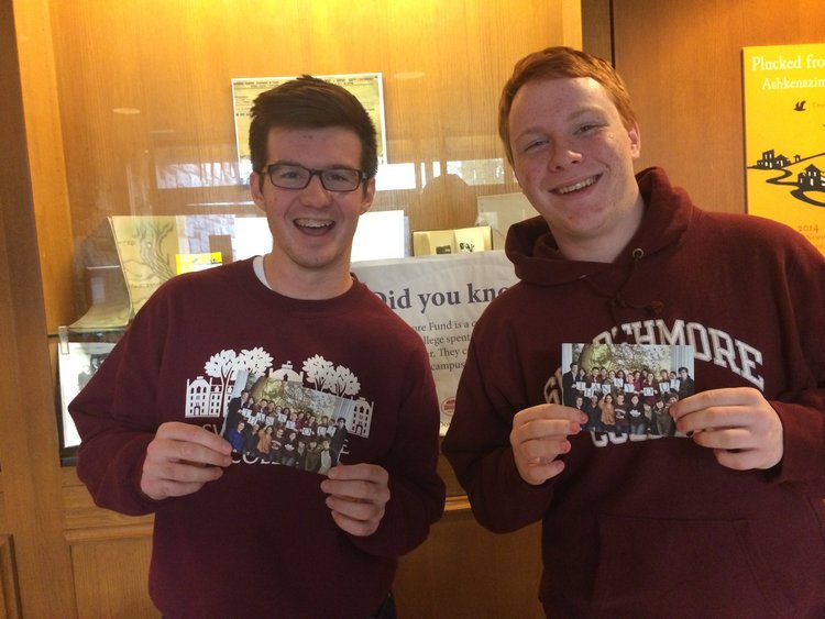 2 students hold up thank you cards at Thank-A-Donor day