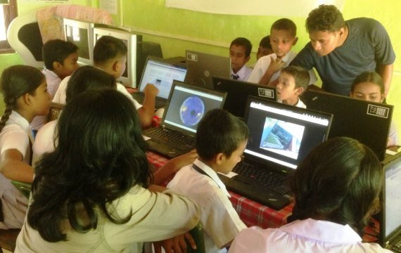 Students familiarizing themselves with the Internet in a classroom in the Kandiyapita village of Sri Lanka.