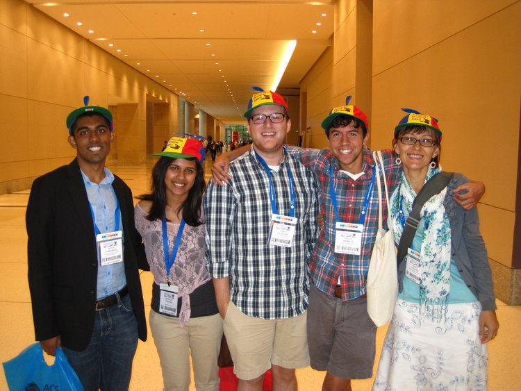 Yatsunyk lab members smiling with propellor hat at ACS conference