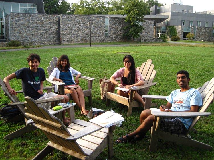 Yatsunyk lab has group meeting outside in beautiful weather.