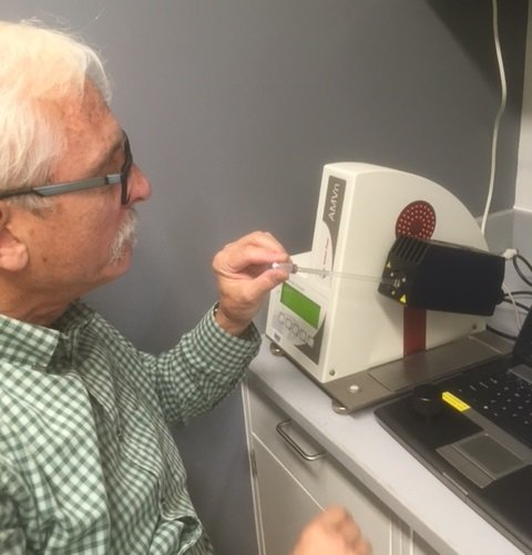 Bill Dean showing me how to use a viscometer to determine the exact viscosity of our buffer, which is an important parameter in fitting AUC data
