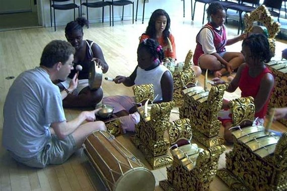 Tom Whitman teaches Chester schoolchildren about gamelan instruments in Lang Concert Hall.
