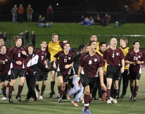 Philippe Celestin '11 leads the mens soccer team in celebration