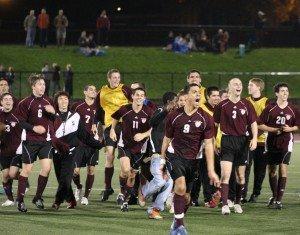 Philippe Celestin '11 leads the mens soccer team in celebration