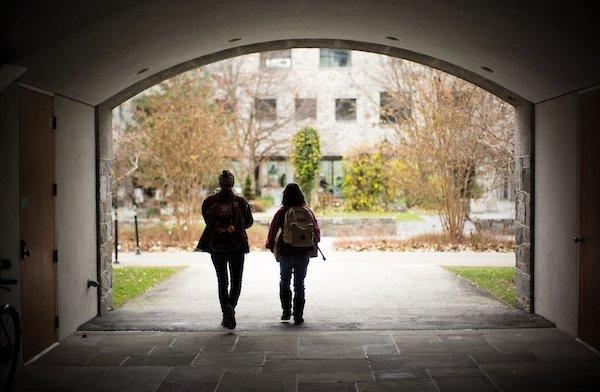 two students walking through Kohlberg breezeway