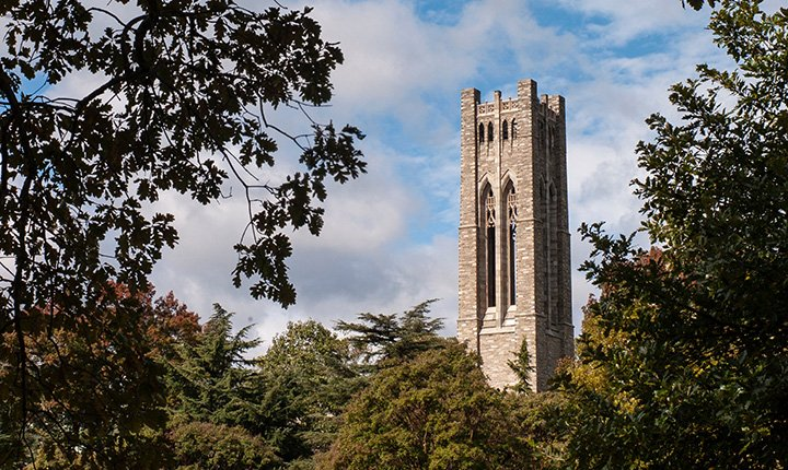 Clothier tower framed by fall foliage
