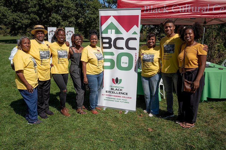Community members pose with sign celebrating 50th Anniversary of BCC