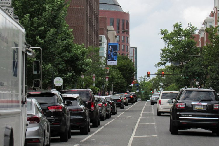Line of cars on street