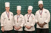 Cooks from Dining Services wearing silver medals