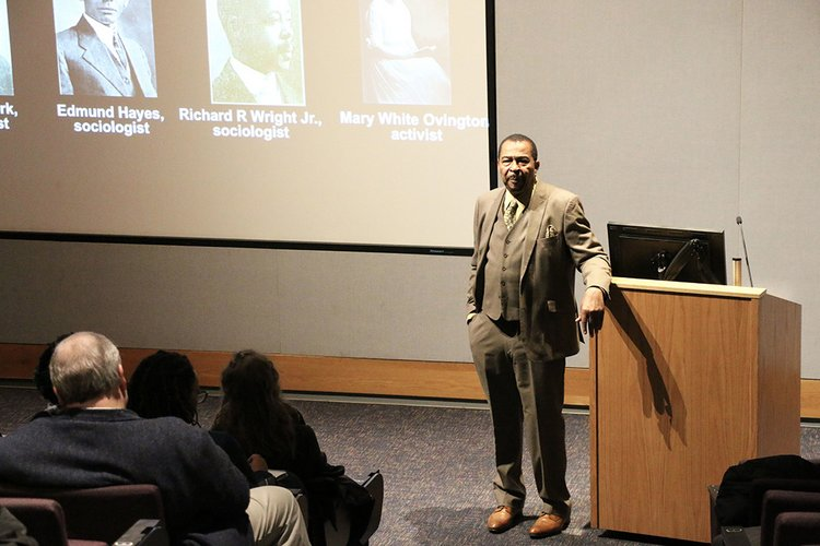 Aldon Morris speaks in front of screen in Lang Performing Arts Center