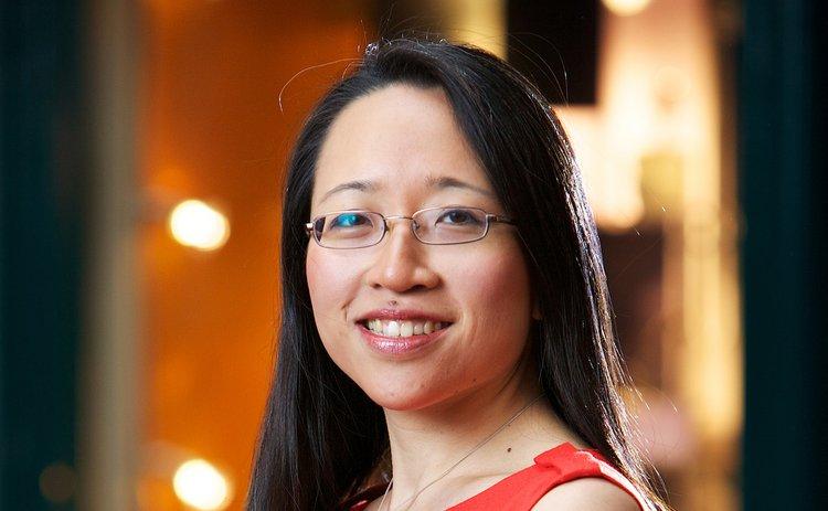 Portrait of woman wearing red