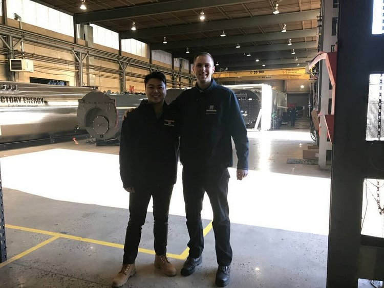 Eugene Prymak '13 and William Huang '23 in warehouse