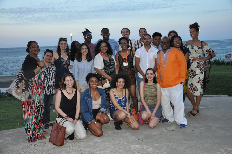 group shot of students and staff on beach in Cuba