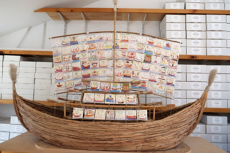 Ship made of wood with pictures of boats
