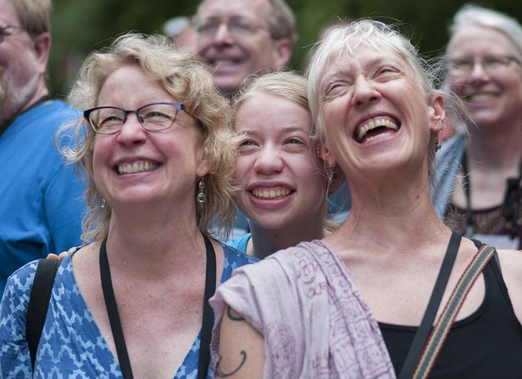 Three generations of women smile at the camera