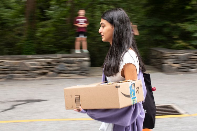 Student carries box