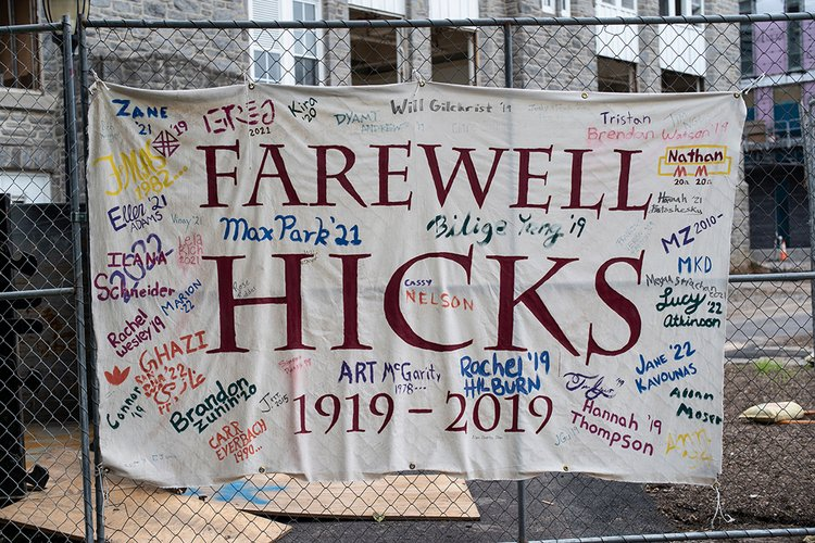 """Farewell Hicks Hall"" hangs on fence outside of Hicks"