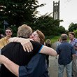 Reunited classmates hug during Alumni Weekend
