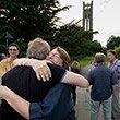 Reunited classmates hug during Alumni Weekend