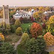 An aerial photo of Clothier Bell Tower and Parrish Hall surrounded by fall foliage