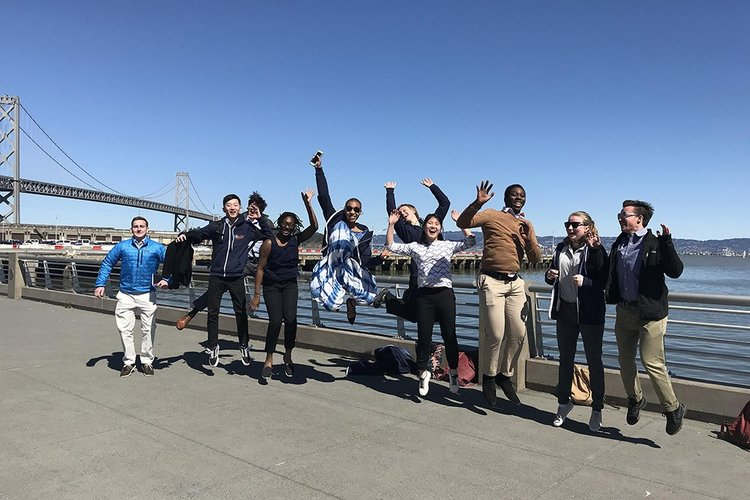Students jump in front of bridge on CIL trip
