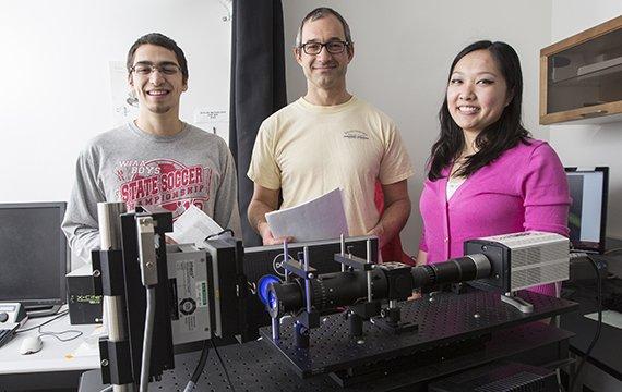 Professor Nick Kaplinsky with Erin Kast '15 and Stephanie Wey '16