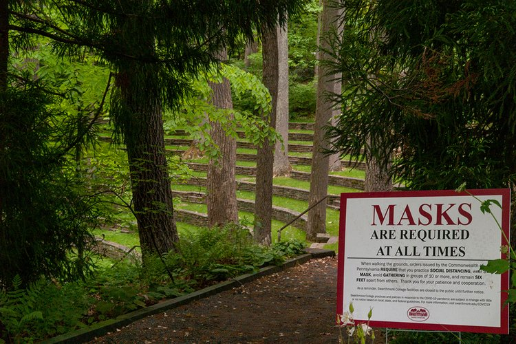 Outdoor amphitheater with sign indicating masks are required at all times