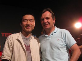 Feng He '03 (left) with TED chief curator Chris Anderson