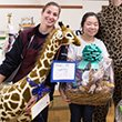 Students hold prizes from charity putt-putt event