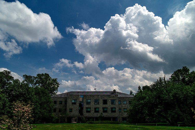 Kohlberg Hall underneath a blue sky with white clouds
