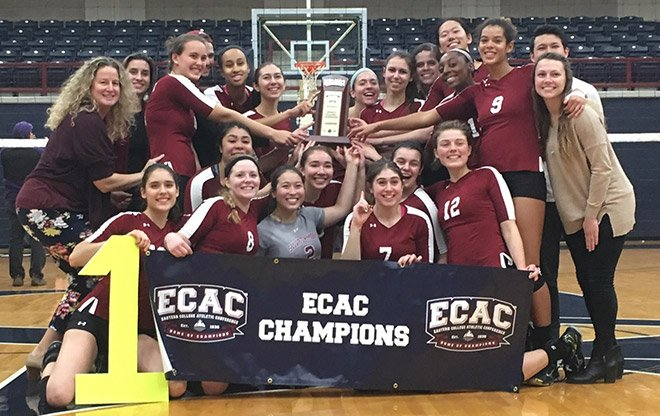 Garnet Volleyball post with their championship trophy