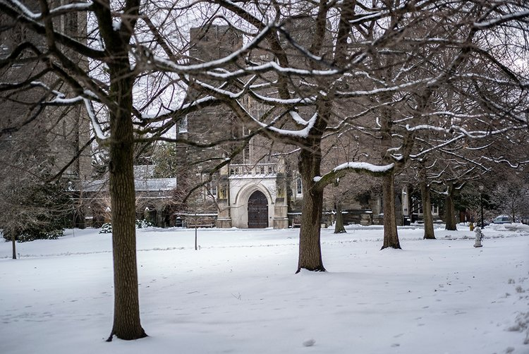 Lawn covered in snow, clothier hall in background