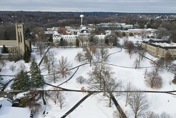 Aerial drone snapshot of campus covered in snow