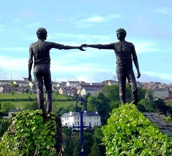 Derry statue of reconciliation - two young men reaching across a divide to shake hands