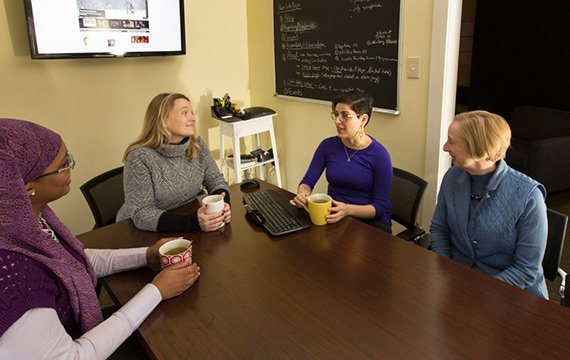 Group of people around conference table