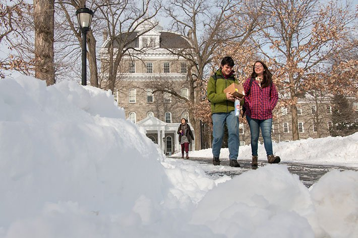 Students walk to class on a snowy day