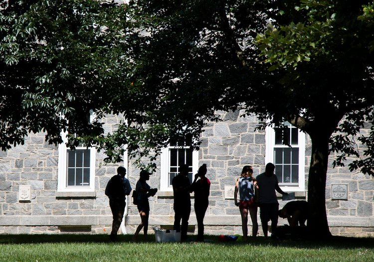 Students play games outside of Parrish Hall