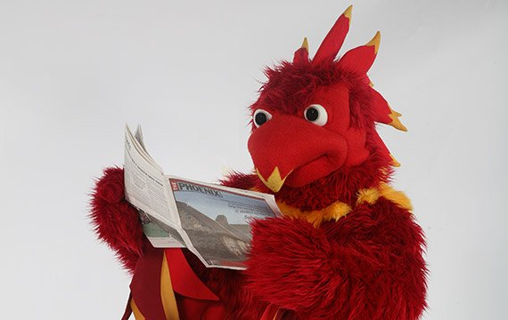 Phineas the Phoenix reading newspaper