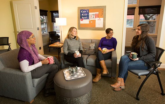 Staff Members meet in circle at Title IX House