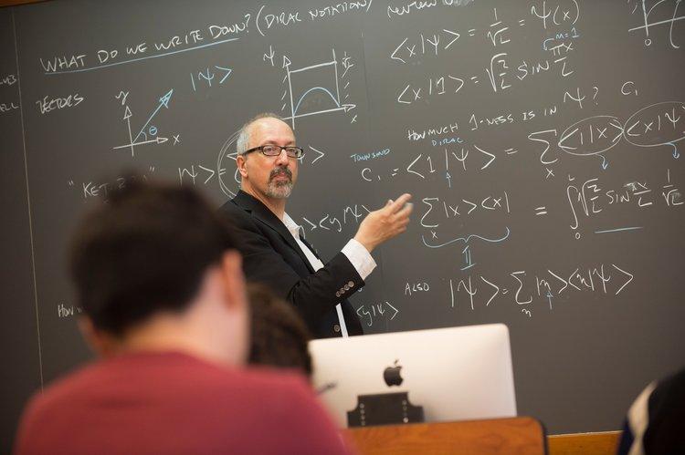 Professor Michael Brown teaching a Physics seminar.