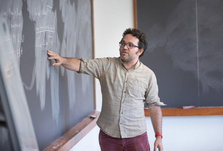 Tristan Smith at blackboard